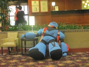 A plush mechanoid relaxes at the International Steampunk Symposium, April 2015.